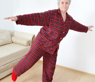 Elderly lady doing gymnastics